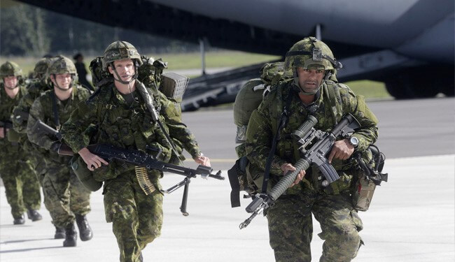 NATO orders four additional battalions to Russian border