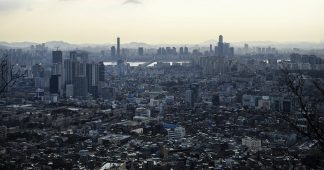 US Families evacuate South Korea, Japanese draw evacuation plans