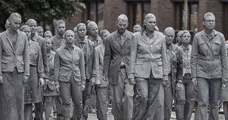 1000 ghostly figures march the streets of hamburg in protest for the G20 summit