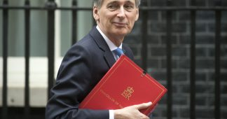 Chancellor Philip Hammond attacks Donald Trump's tax cuts