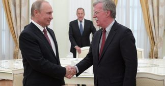 Putin meets Bolton amid nuclear treaty exit tensions