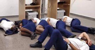 Ryanair sacks cabin crew pictured 'sleeping on airport floor'