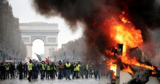 Battlefield Paris: Police hit protesters with tear gas as massive fuel rallies grip France