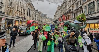 Campaigners march through London in protest against climate change