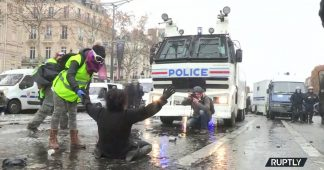 Water cannon & blood: Paris 'Yellow Vest' protest turns violent