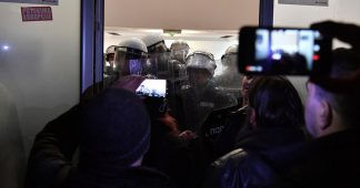Protesters storm public broadcaster HQ in Serbia, face off with riot police