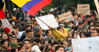 Protests in Colombia, Chile resist government attacks
