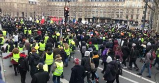 Yellow Vests' and trade unions take to the streets of Paris against pension refo