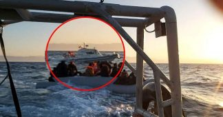 Footage shows Turkish boat escorting migrant dinghy