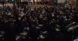 Police use water cannon against protesters in Paris amid clashes over Global Security Bill