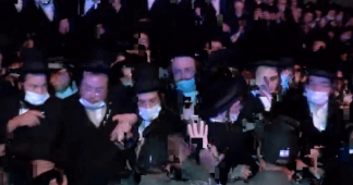 Orthodox Jews defy health protocols & clash with Israeli police at funeral of rabbi who died of Covid-19