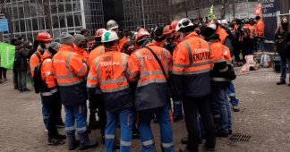 Striking French refinery workers & climate protesters clash with police outside office of oil giant Total