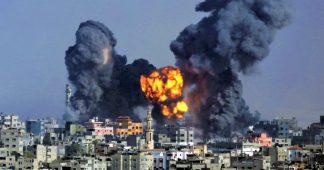 Israel masses forces near Gaza as air strikes continue